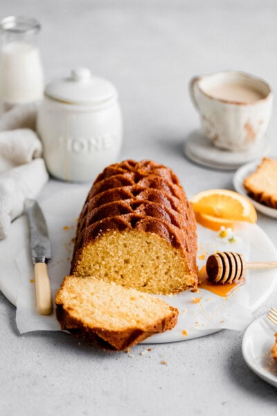 Soft and velvety orange pound cake made with freshly squeeze orange juice and zest. Perfect for a morning snack or brunch dessert.