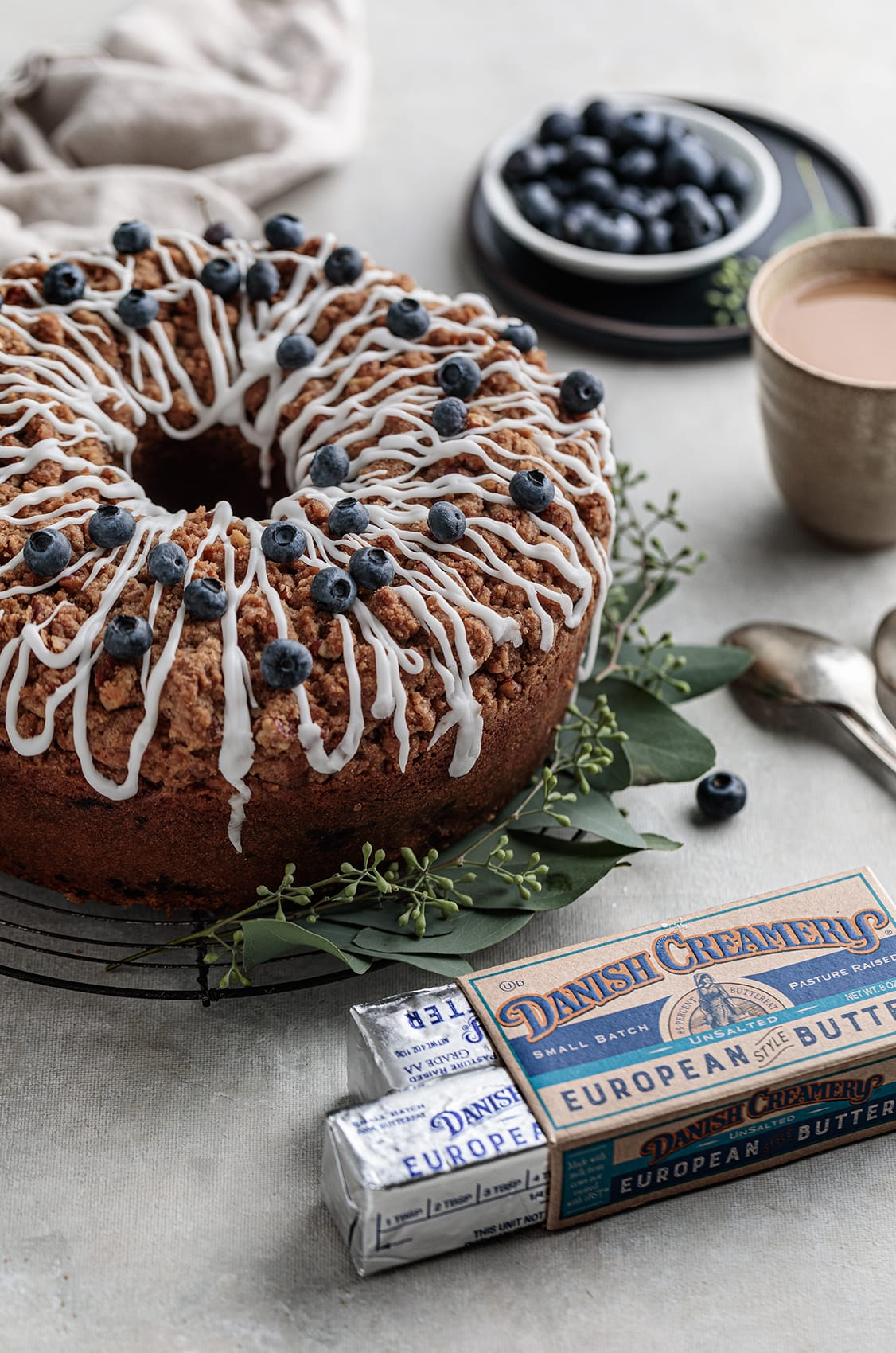 Classic Blueberry Coffee Cake  topped with a buttery pecan streusel and served warm, fresh out of the oven.
