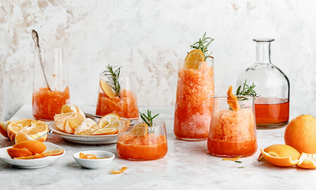 Sweet and citrusy Minneola Aperol Granita is the perfect refreshing drink on a hot summer day!
