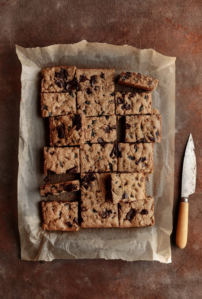 almond butter Chocolate chip cookie bars on parchment paper