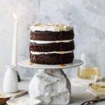 chocolate tahini cake on cake stand