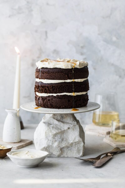 chocolate tahini cake on cake stand