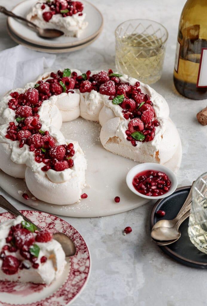 pavlova wreath with raspberries and cream.