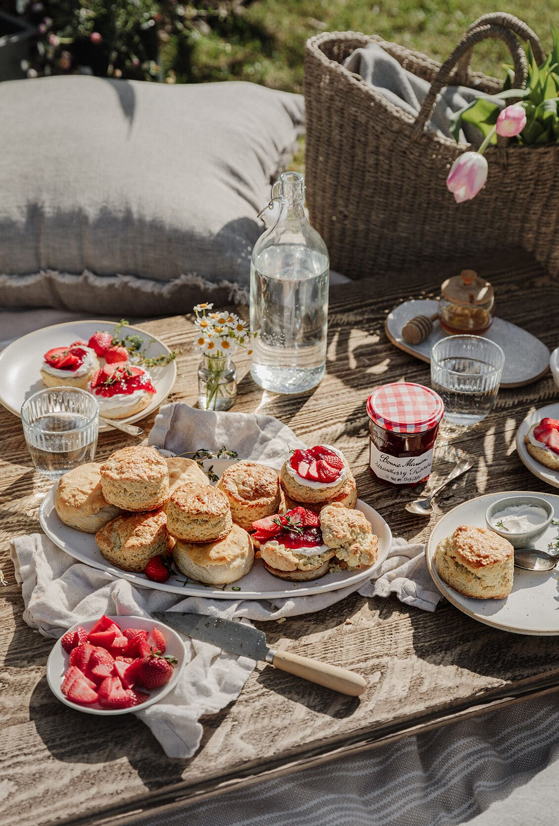 Buttery strawberry shortcakes filled with creamy whipped labneh and strawberry preserves. The perfect dessert to enjoy on an afternoon picnic!