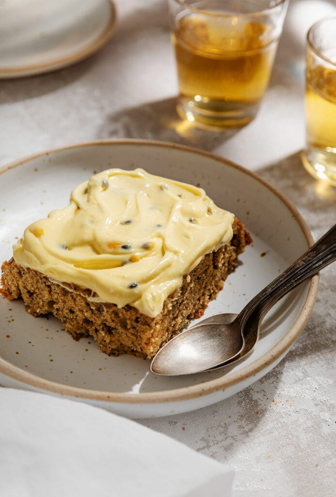 slice of banana cake with passion fruit frosting